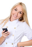 The young smiling nurse with mobile phone Stock Photography
