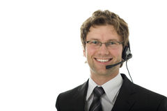 Young smiling operator isolated over white. Young business man wearing glasses and headset stock images