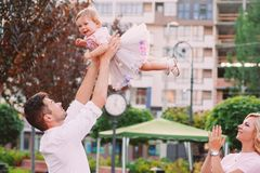 Young smiling parents with their baby outdoor in the park Stock Photography