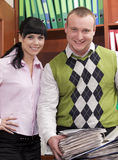 Young smiling people in office stock image