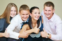 Young smiling peoples thumb up Royalty Free Stock Image