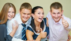 Young smiling peoples thumb up Royalty Free Stock Photos