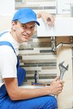 Young smiling plumber man worker Royalty Free Stock Photography