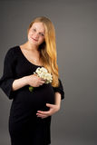 Young smiling pregnant blonde woman Stock Photo