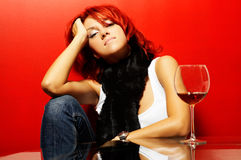 Young smiling pretty woman over red Royalty Free Stock Photos