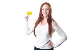 Young smiling redhead woman holding gold credit card Stock Photography