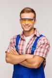 Young smiling repairman in eyewear Stock Photo