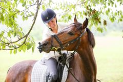Free Young Smiling Rider Woman Touching Lips Of Horse Royalty Free Stock Photography - 101500427