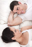 Young smiling romantic couple lying in bed Royalty Free Stock Photos