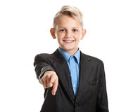 Young smiling schoolboy pointing Royalty Free Stock Photo