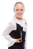 Young smiling schoolgirl holds Royalty Free Stock Photography