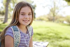 Young smiling schoolgirl looking to camera, portrait stock images