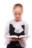 Young smiling schoolgirl read Royalty Free Stock Photos