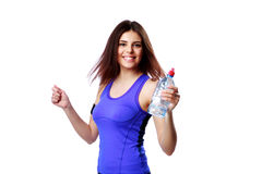 Young smiling sport woman holding bottle with water Stock Images