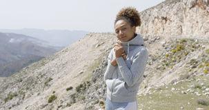 Young smiling sportive woman posing on nature Stock Photos