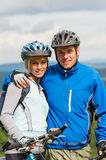 Young sporty couple with mountain bikes in helmet Royalty Free Stock Images