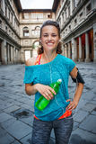 Young smiling sporty woman with bottle of water. Florence Stock Images