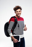 Young smiling student with backpack Stock Photo