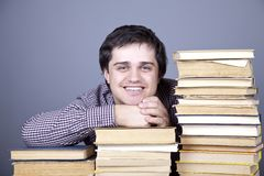 The young smiling student with the books isolated. Royalty Free Stock Images