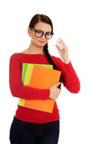 Young smiling student woman holding books royalty free stock photo