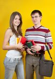 Young smiling students with books stock images