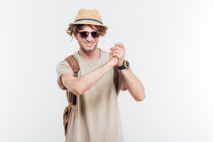 Young smiling stylish man showing well done gesture Royalty Free Stock Image