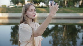 Young smiling teen happy woman making selfie on the street stock video