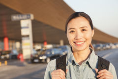 Young Smiling traveler portrait outside of airport Royalty Free Stock Photos