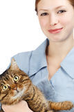 Young smiling veterinarian woman and adult big-eyed tabby cat Royalty Free Stock Photography