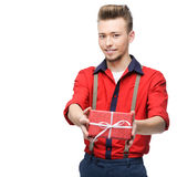 Young smiling vintage man holding gift Stock Photos