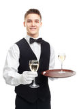 Young smiling waiter holding glasses of wine Stock Images