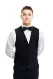Young smiling waiter isolated on white background Royalty Free Stock Image