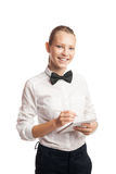 Young smiling waitress taking order with notebook and pencil Royalty Free Stock Photography