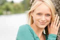 Young and smiling woman Stock Photos