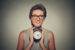 Young smiling woman with alarm clock Stock Images