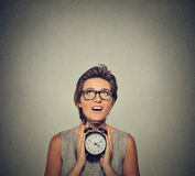 Young smiling woman with alarm clock looking up Royalty Free Stock Photography