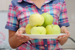 Young smiling woman in american style shirt with apples Royalty Free Stock Photo
