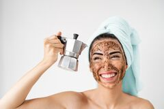 Free Young Smiling Woman Applying Coffee Scrub Mask On Face - Happy Girl Having Healthy Skin Care Spa Day At Home Stock Photography - 184897462