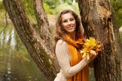 Young smiling woman in  autumn park Stock Photo