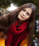 Young smiling woman in autumn park Royalty Free Stock Image