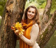 Young smiling woman in  autumn park Stock Photos