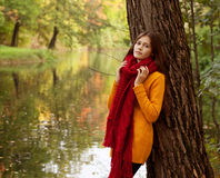 Young smiling woman in autumn park Stock Photography