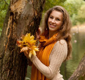 Young smiling woman in autumn park Stock Image