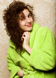 Young smiling woman in bathrobe Stock Image