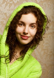 Young smiling woman in bathrobe Stock Images