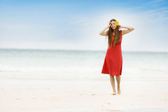 Young smiling woman on beach Stock Image