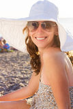 Young smiling woman at the beach near sea Royalty Free Stock Image