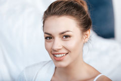 Young smiling woman in bed Royalty Free Stock Photo