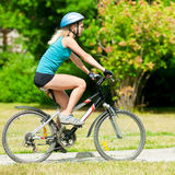 Young smiling woman on bike Stock Images