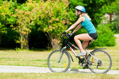 Young smiling woman on bike Stock Photo